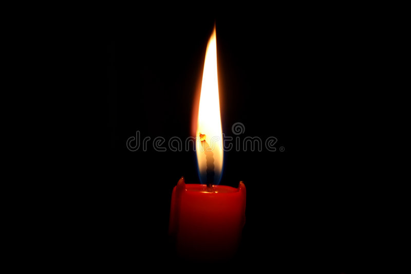 Red Candle. Red burning Candle Fire Spiritual & Religious black background stock photography