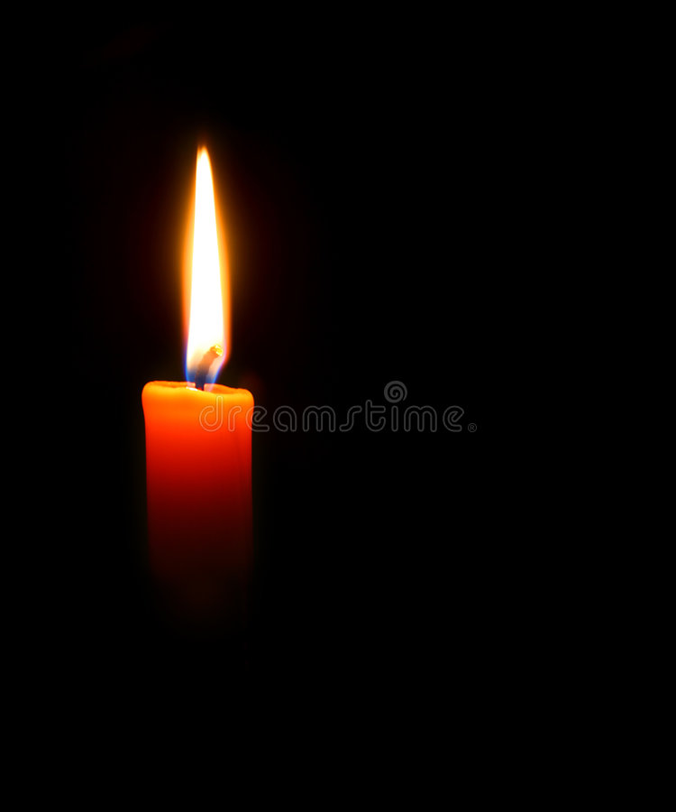 Red candle. Glowing in the dark. Back background stock photo