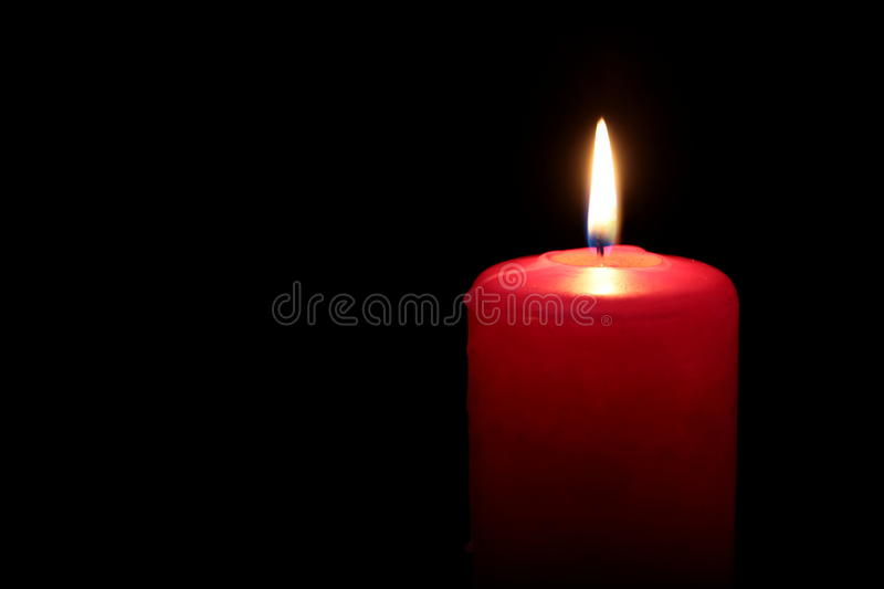 Red Candle. On black background royalty free stock image