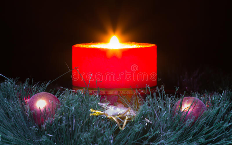 Red candle with fire. Against defocused lights royalty free stock photos