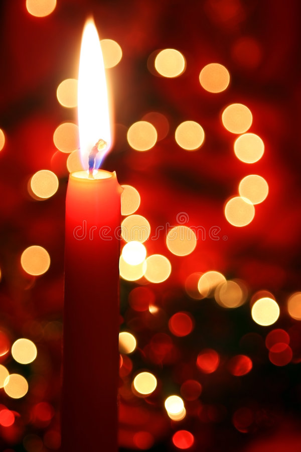 Red Candle with Lights. Red candle with colorful defocussed lights. A perfect festive background royalty free stock image