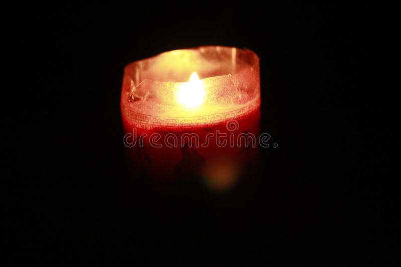 Red candle lights..bright of the dark stock photo