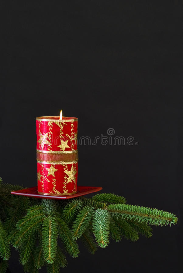 Red Candle On Spruce Branch Royalty Free Stock Photography