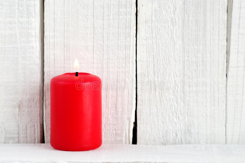 Red candle on wood. En background royalty free stock images