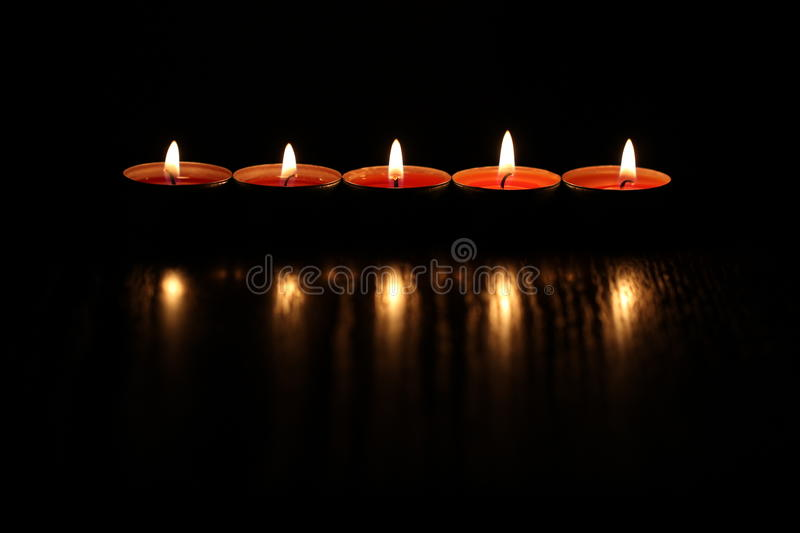 Red candles on dark background
