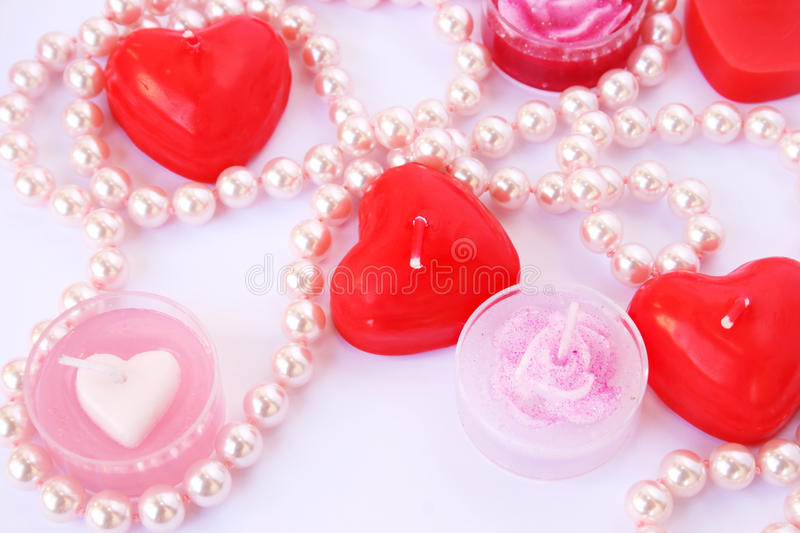 Red candles and necklace stock images