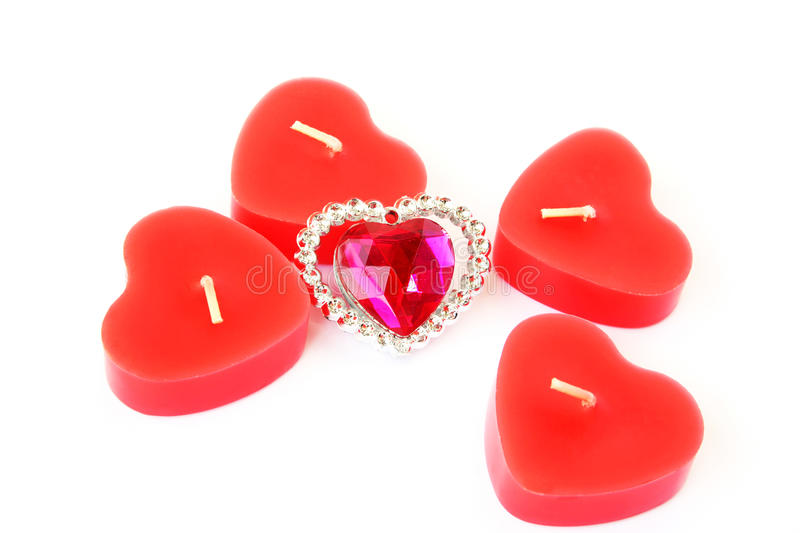 Red candles and pink stone stock photo