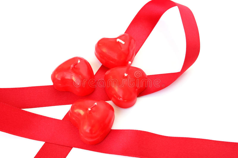 Red candles and ribbon royalty free stock photo