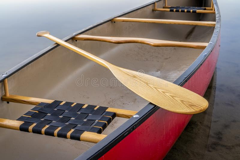 Red canoe on a calm lake stock photography
