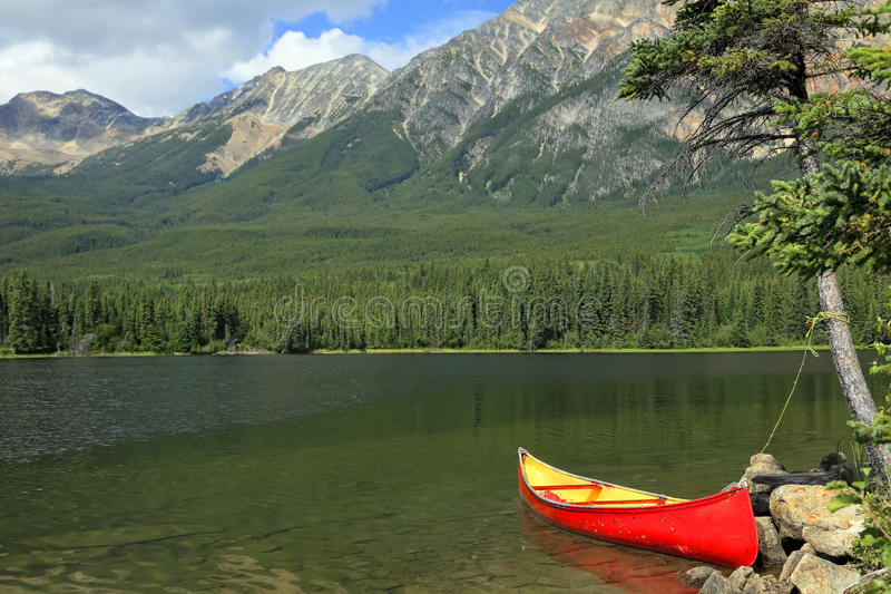 Download Red Canoe Moored On The Bank Stock Image - Image: 25461327