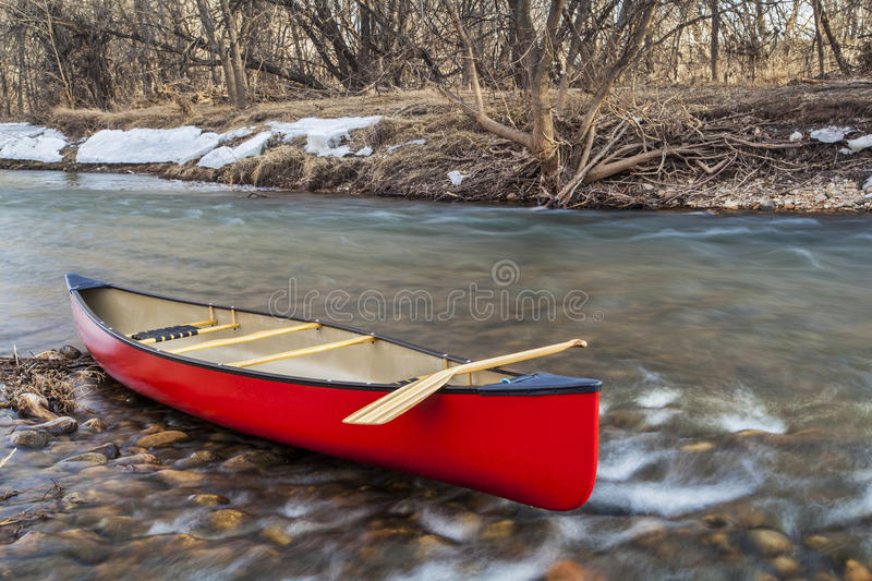 Red canoe on a river