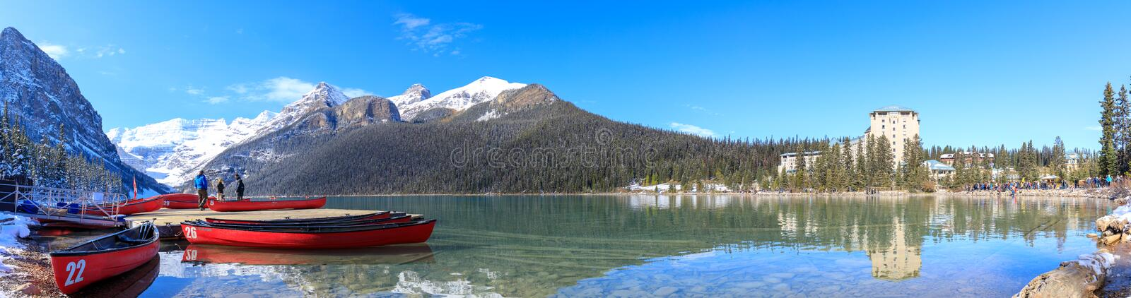 Red canoes at Lake Louise with rocky mountain in Banff national park. Alberta, Canada - October 7, 2018 : Red canoes at Lake Louise with rocky mountain in Banff royalty free stock photography