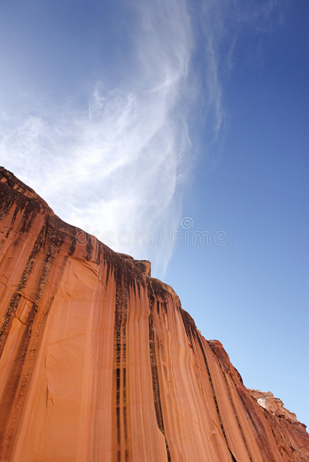 Red Canyon Wall. An abstract view of a towering sandstone cliff in the desert of the American southwest royalty free stock photos