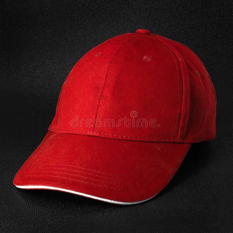 Red cap dark background. Template of baseball cap in side view. Red cap stock photos