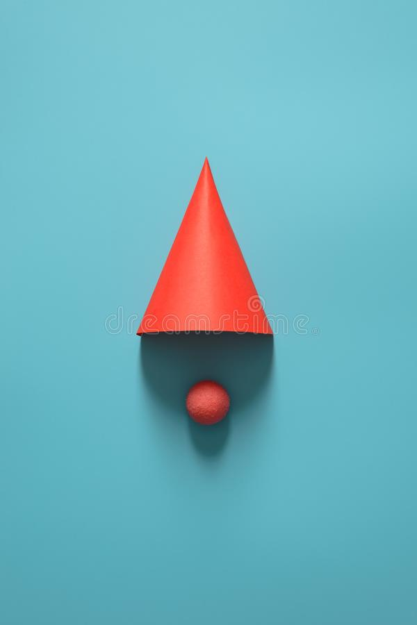 Red cap for party, Christmas, happy new year or other holiday. On a blue background. The minimalist concept. Copy space for your. Red cap for party, Christmas royalty free stock photos