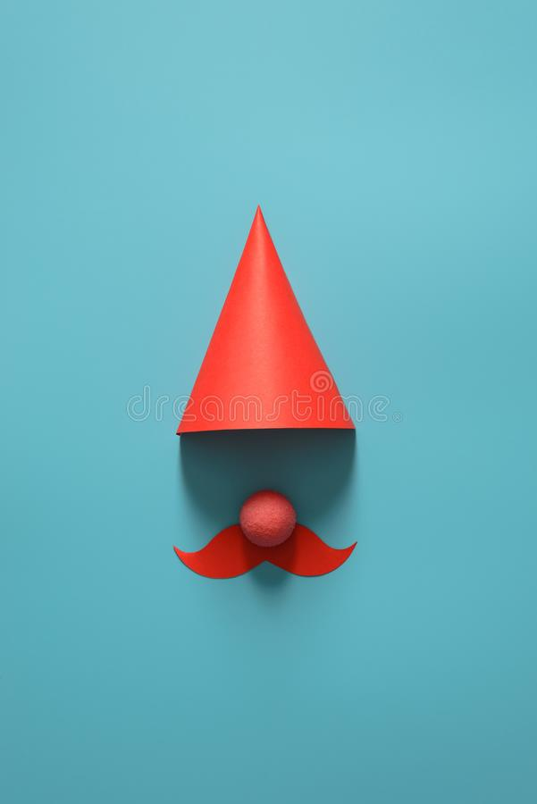 Red cap for party, Christmas, happy new year or other holiday. On a blue background. The minimalist concept. Copy space for your. Red cap for party, Christmas royalty free stock photo