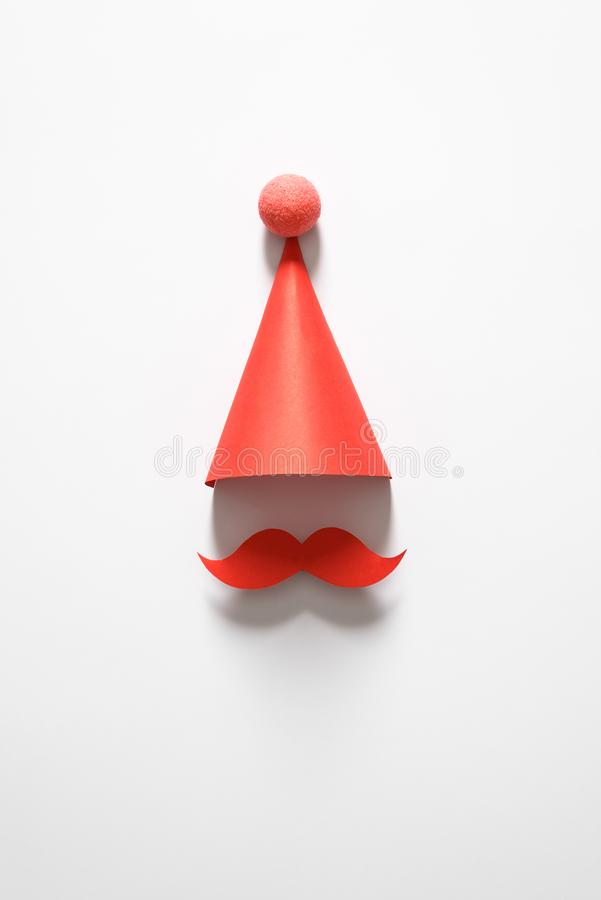 Red cap for party, Christmas, happy new year or other holiday. On a white background. The minimalist concept. Copy space for your. Red cap for party, Christmas royalty free stock images