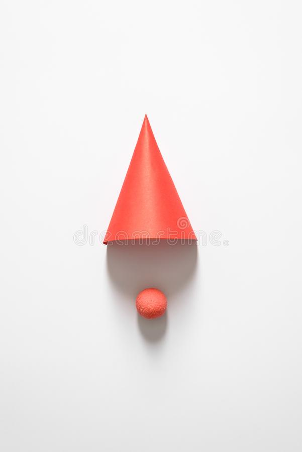 Red cap for party, Christmas, happy new year or other holiday. On a white background. The minimalist concept. Copy space for your. Red cap for party, Christmas royalty free stock photography