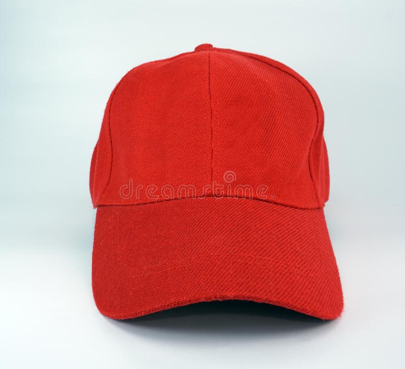 Red cap on white background. Red cap front view on white background stock images