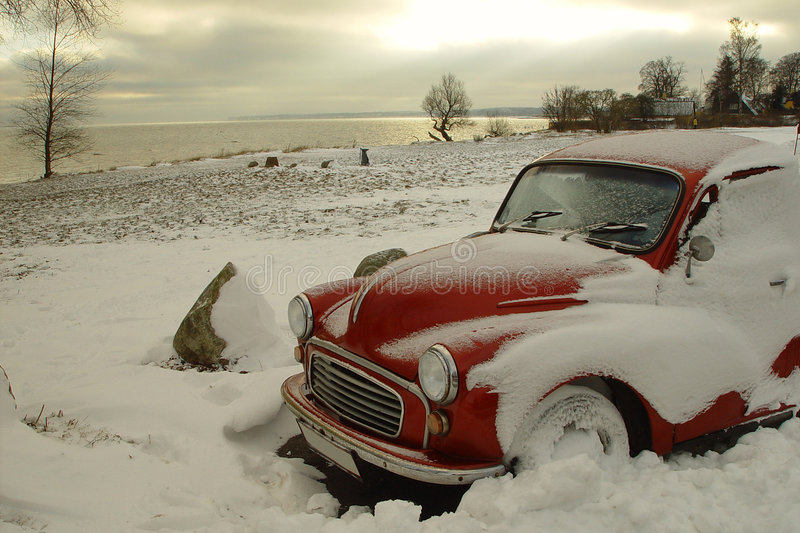 Red car. Red classic car in a snowlandscape royalty free stock images