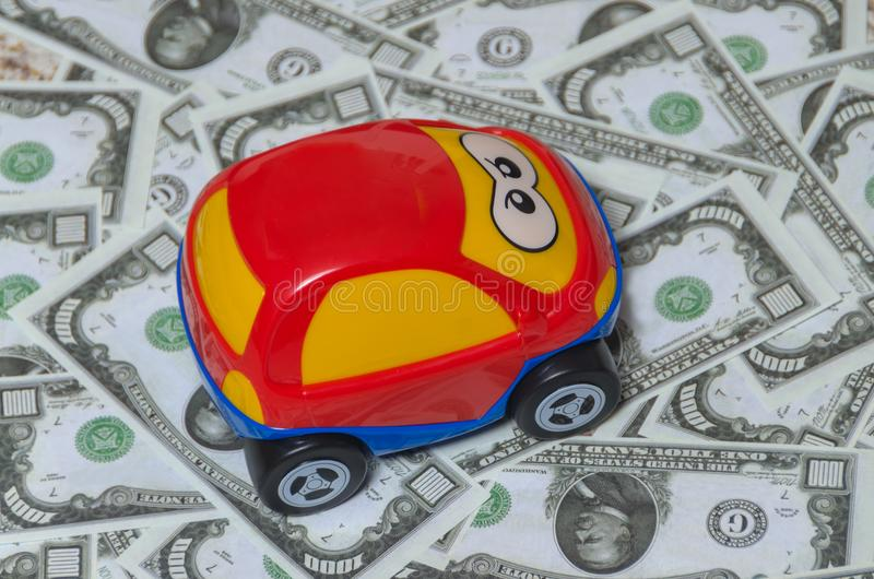 The red car on a background of money, the dollar. Close-up, the red car on a background of money, the dollar royalty free stock image