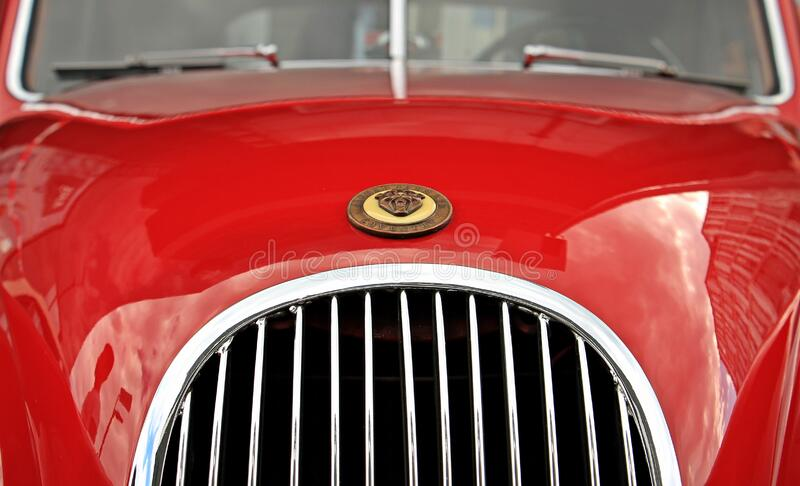 Red Car With Brown Emblem stock images