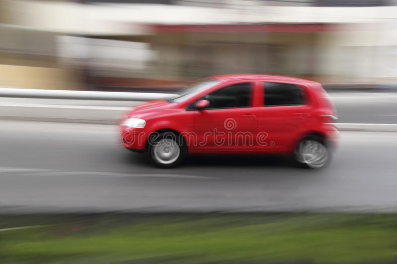 Red car at a city street. stock photo