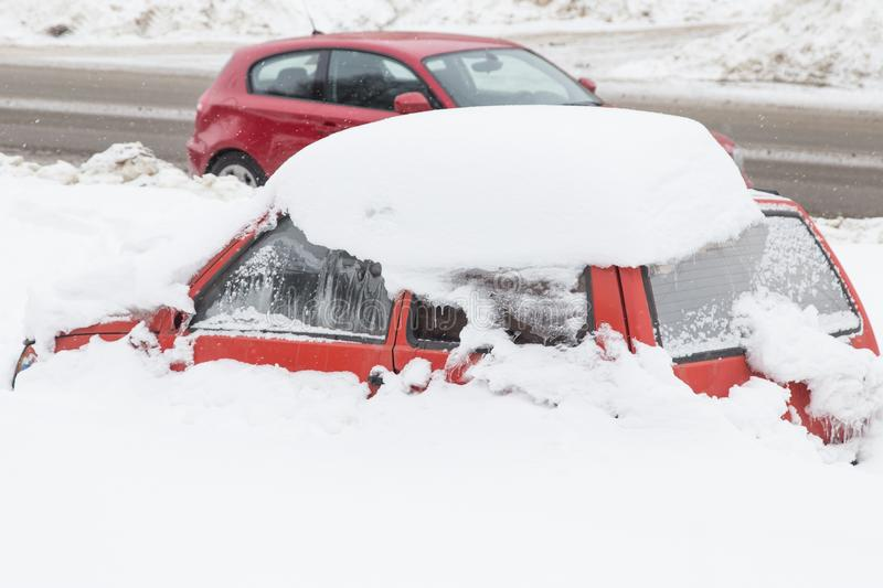 Red car covered snow stock photography