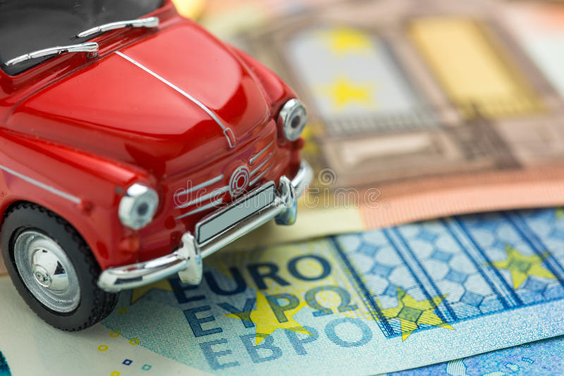 A red car on Euro banknotes. Macro stock photo