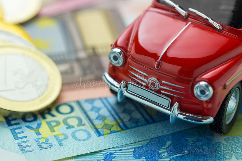 A red car on Euro banknotes. Macro royalty free stock photo