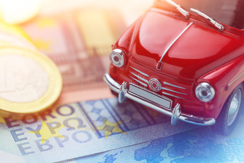 A red car on Euro banknotes. Macro stock photography