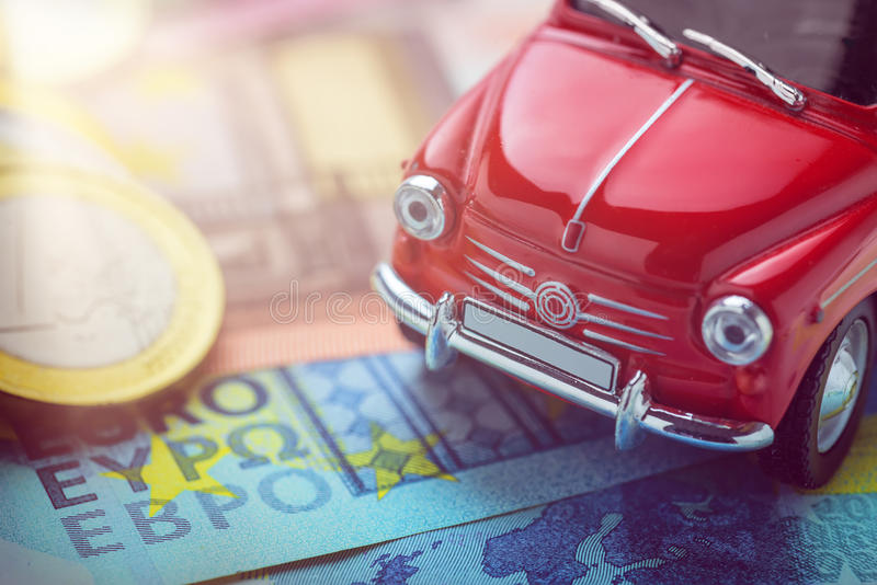 A red car on Euro banknotes. Macro royalty free stock image
