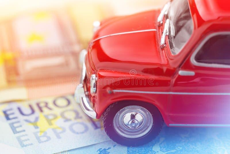 A red car on Euro banknotes. Macro stock photos