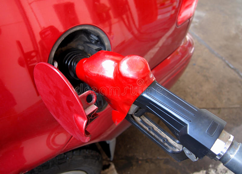 Red car with a gas pump stock images