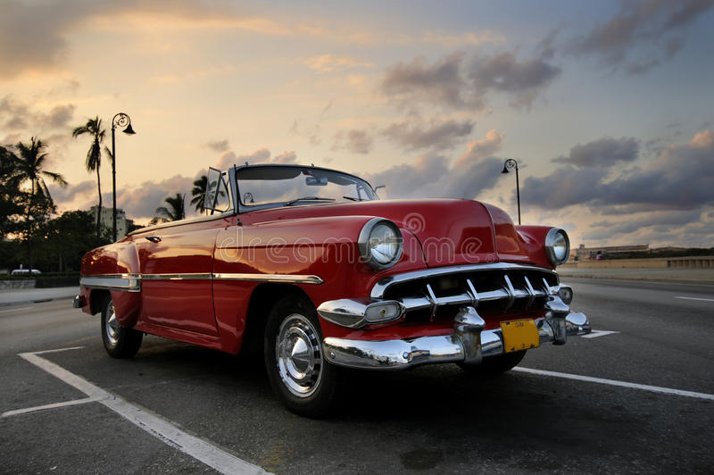 Red car in Havana sunset stock photos