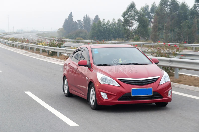 Red car on highway. One red car on highway in China Guangdong royalty free stock images