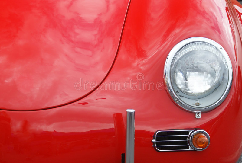 Red Car hood with lights. And reflection of clouds in sky. All Logo and names removed royalty free stock photos
