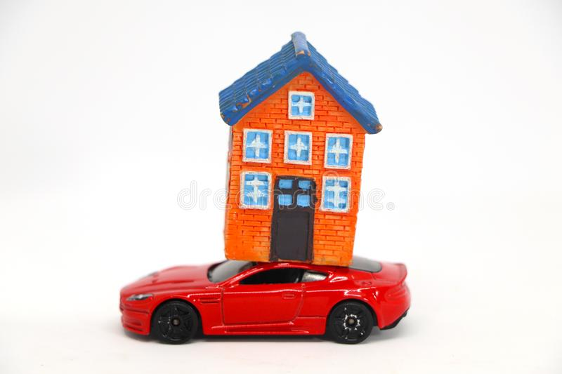 Red car with house model. On white background. concept of buy sell royalty free stock image