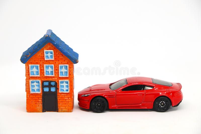 Red car with house model. On white background. concept of buy sell royalty free stock images