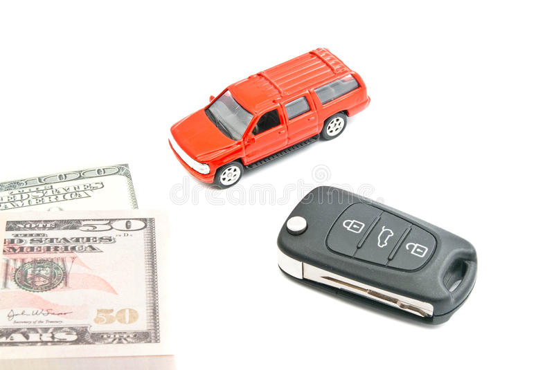 Red car, keys and notes. Red car with keys and money closeup on white background stock image