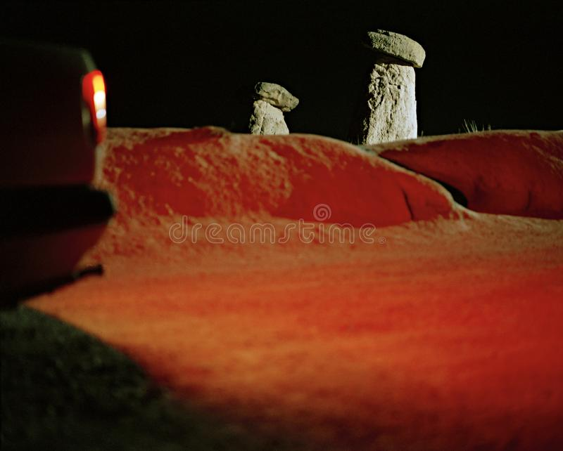 Red car light changes the color of the sand in Urgup Cappadocia in Turkey,. Red car light changes the color of the sand in Urgup Cappadocia in Turkey stock photography