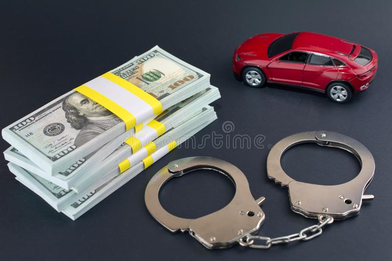 Red car  money handcuffs.  breaking the law auto dealer. Car Dealer Fraud Law concept stock images