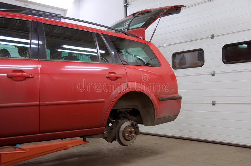Download Red car on raiser stock photo. Image of mechanic, exchange - 9590892