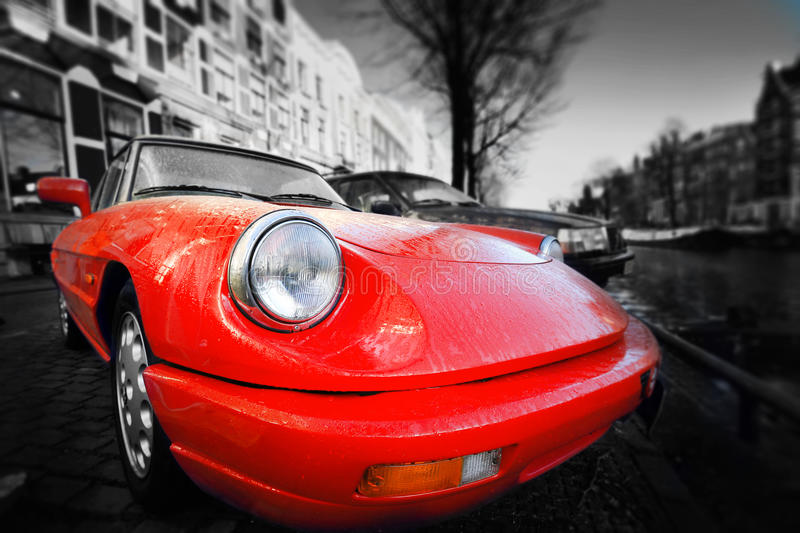 Red car. Red retro car on the waterfront of Paris royalty free stock photo