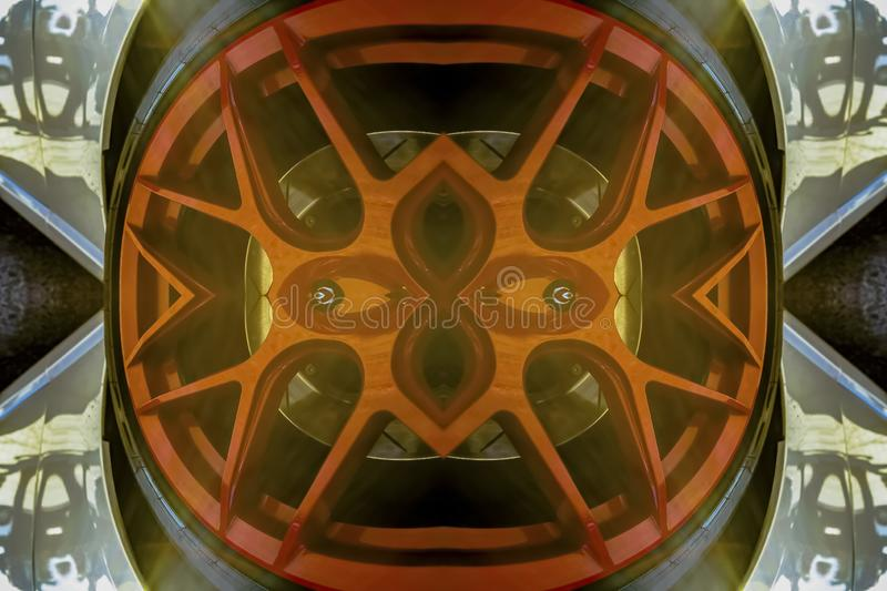 Red car rims made into a reflective design. Geometric kaleidoscope pattern on mirrored axis of symmetry reflection. Colorful shapes as a wallpaper for royalty free illustration