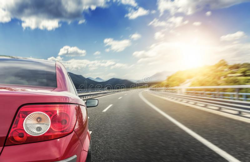 Red car rushing along a high-speed highway. Toned photo royalty free stock photo
