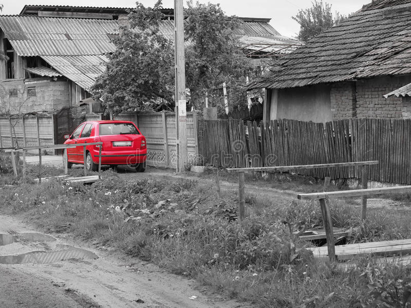 Red car - selective colour. A red car in a rural area. Selective colour filter applied stock photography