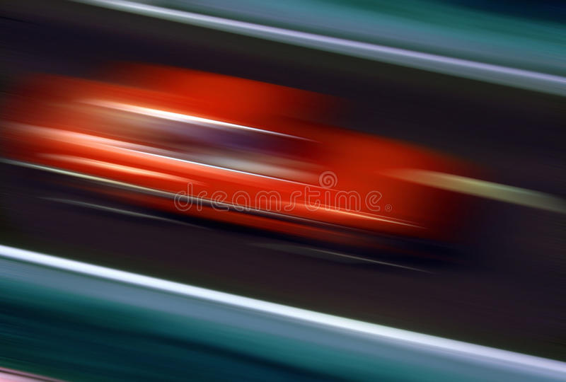 Speeding - Red Car - Speed. Red car traveling on a highway at high speed - blur effect - Speeding stock image