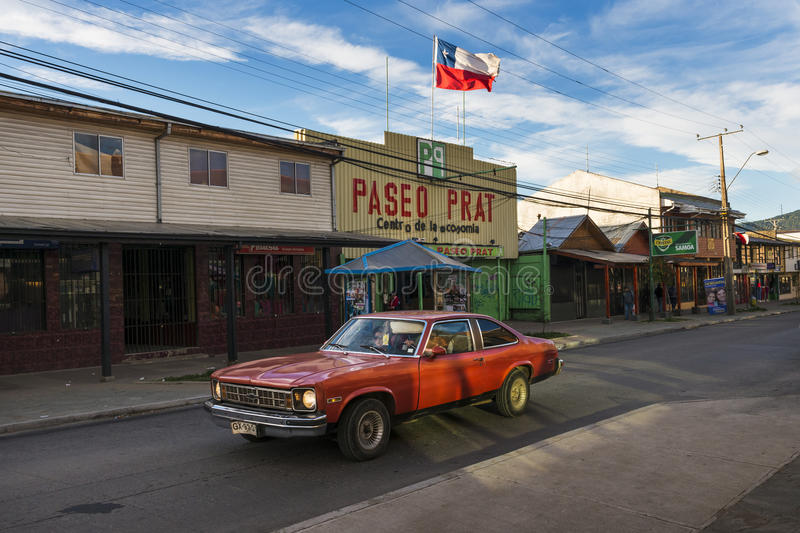 A red car in a street of the town of Coyhaique in Chile, South America royalty free stock image