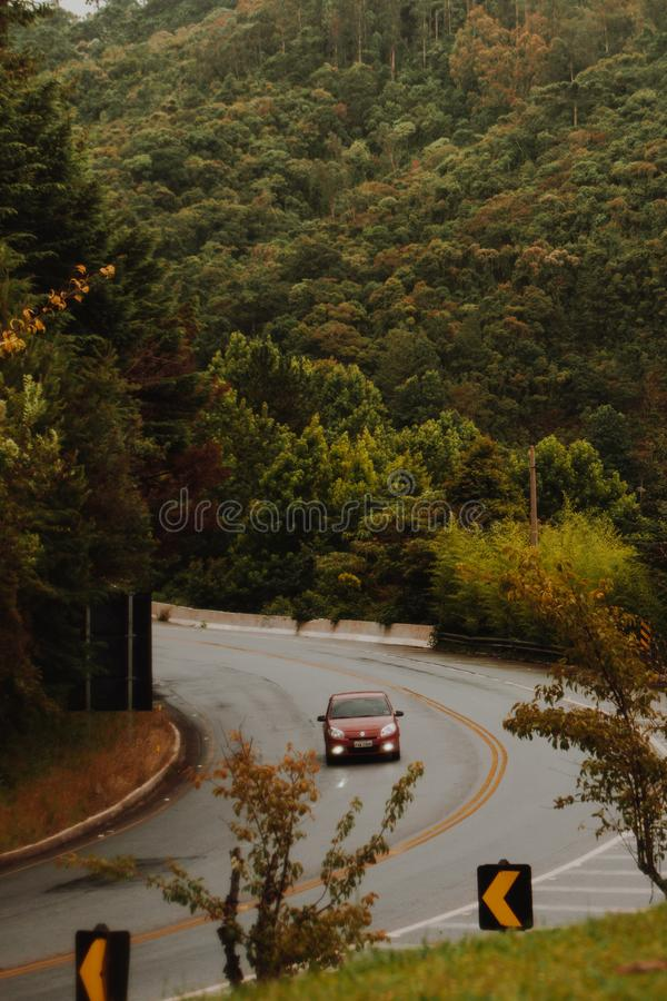 Red Car Travels on the Curved Road stock images